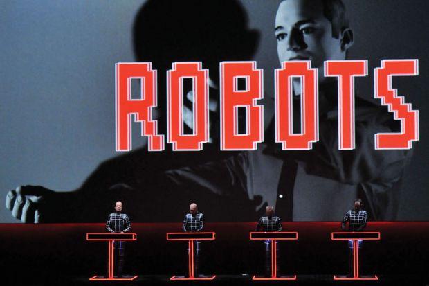 Ralf Hutter, Henning Schmitz, Fritz Hilpert and Falk Grieffenhagen, of German electronic pioneers Kraftwerk, perform live on stage during the first night of their Catalogue retrospective at the Tate Modern Turbine Hall