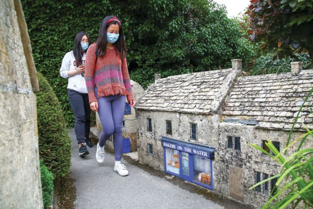 Visitors wearing a face mask  during their visit to the re-opened Model Village for UK quarantine capacity for red-list arrivals risks being 'overwhelmed'