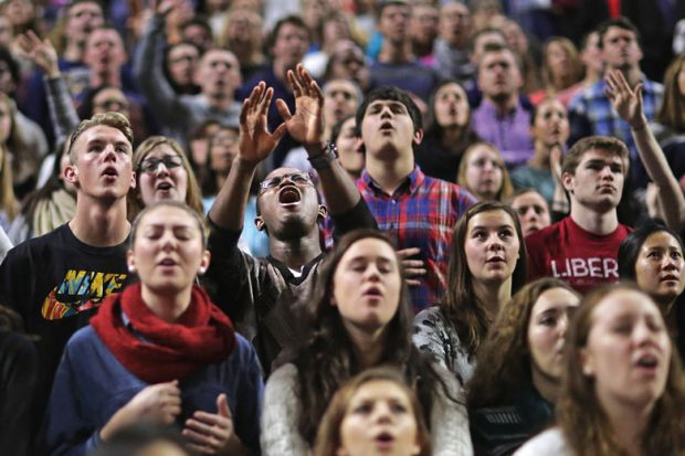 Large crowd of students singing for Liberty after Falwell struggling with diversity