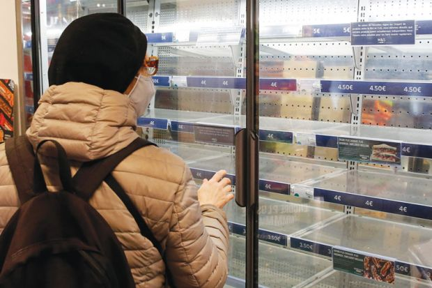 Person looking at empty shelves in a supermarket as a metaphor for Supply shortages snarl US laboratories