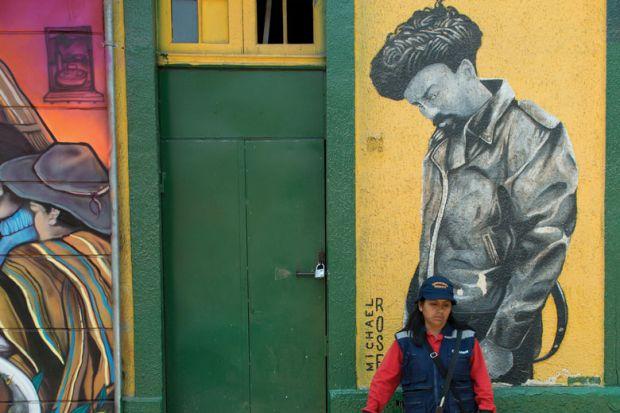 Woman standing in front of door, Santiago, Santiago Metropolitan Region, Chile