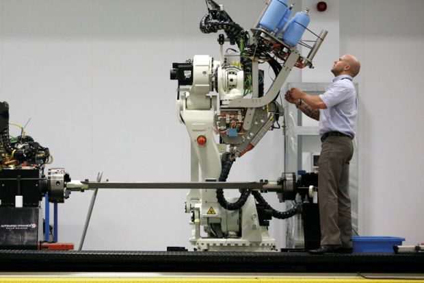 Man at machinery at the Advanced Manufacturing Research Centre.