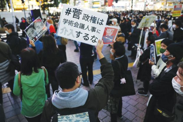 People stage a rally in Tokyo's Shibuya district on Oct. 18, 2020, against Japanese Prime Minister Yoshihide Suga's decision not to appoint academics who have been critical of the nation's security and anti-conspiracy legislation to  the Science Council o