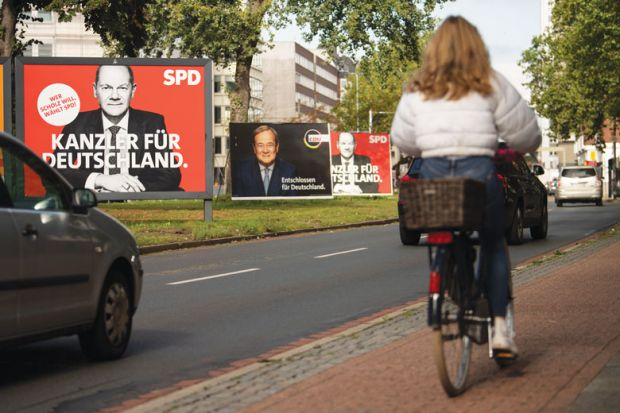 Election campaign billboards showing Olaf Scholz, chancellor candidate of the German Social Democrats (SPD), and Armin Laschet, chancellor candidate of the Christian Democrats (CDU/CSU) illustrating the current election campaign