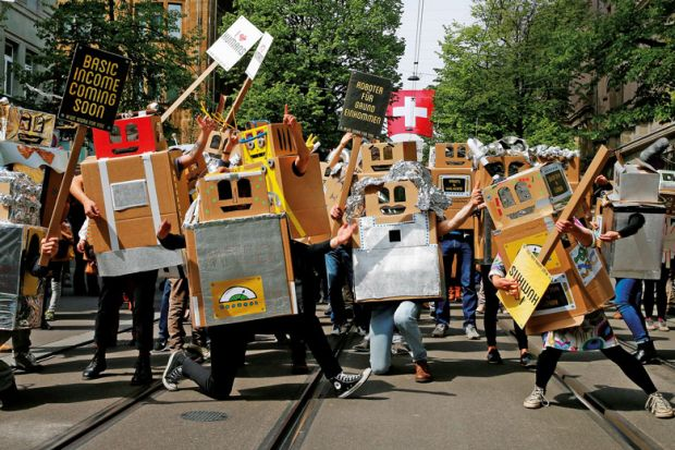 people dressed in boxes with banners as robots