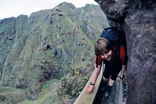lady tight path smiling_climb_rocks getty.jpg