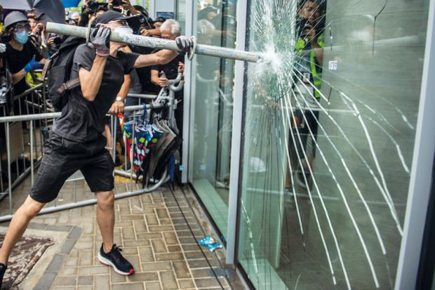 man smash window glass protest_getty.jpg