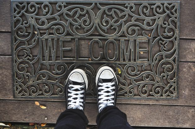 Welcome mat metaphor for scholarships incentive EU students in the UK