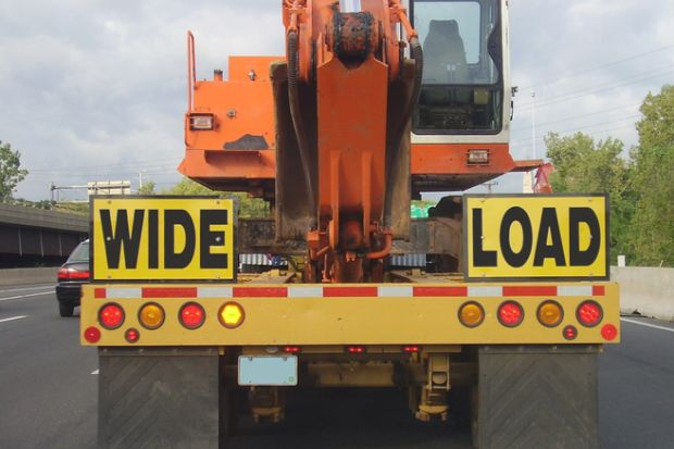 """A lorry with a """"wide load"""" sign"""