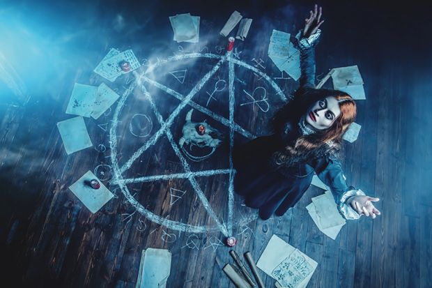 Witch in pentagram