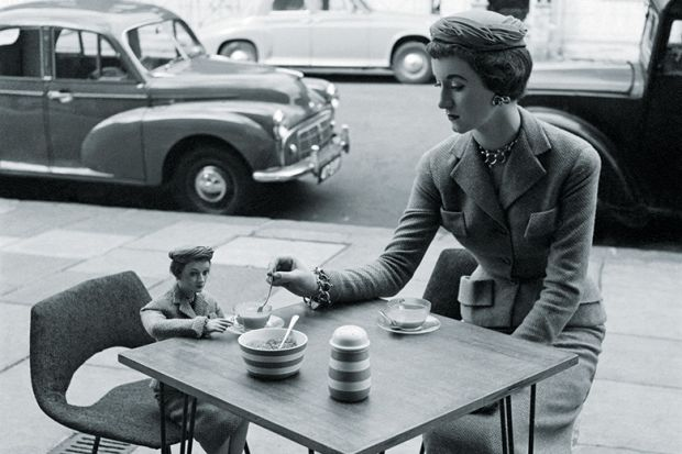 Woman sitting at a cafe with her miniature