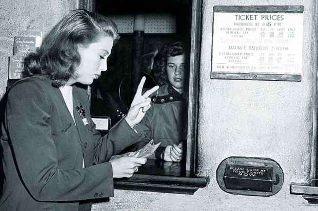 Woman buying two tickets