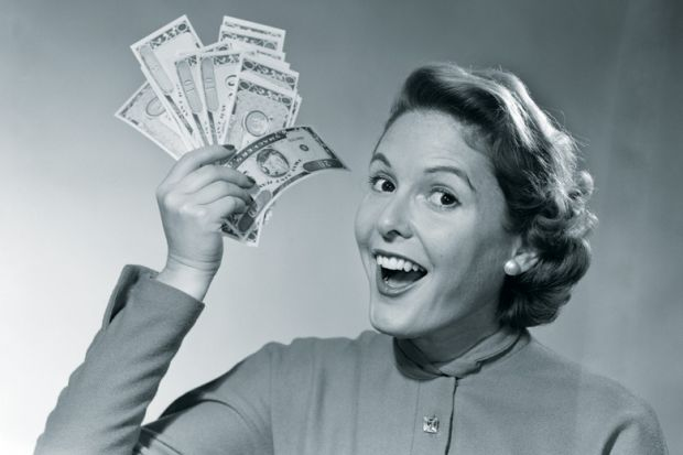 Woman holding handful of cash (black and white)