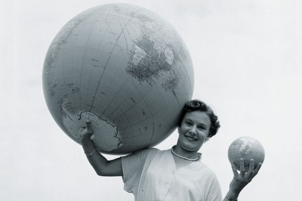 Woman holding large and small globes
