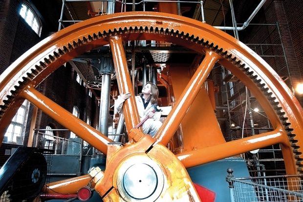 Woman in large wheel