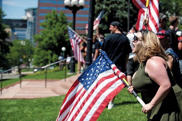 Woman shouting with American flag