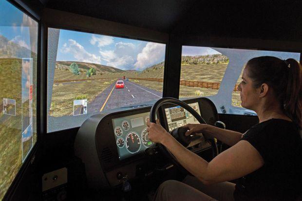 Woman using simulator to drive
