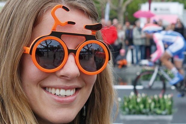 Woman with bicycle sunglasses