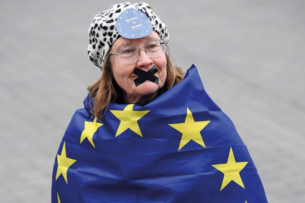 Woman wrapped in EU flag