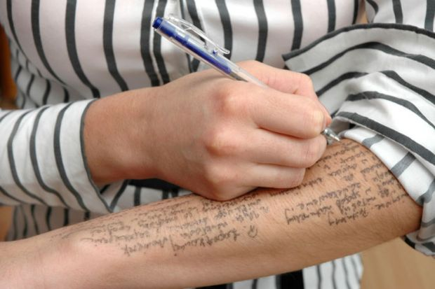 Exam cheating, woman writing notes on arm