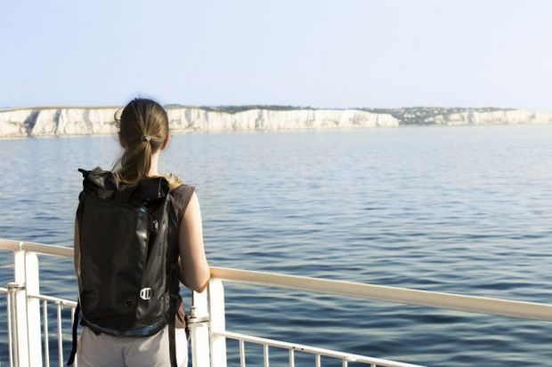 Woman looking out to white cliffs of Dover