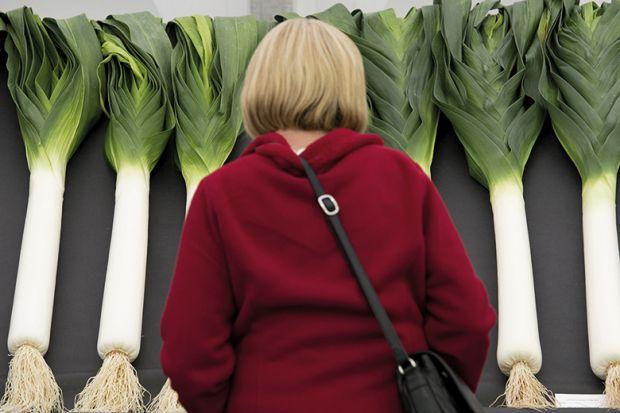 A woman looking at leeks