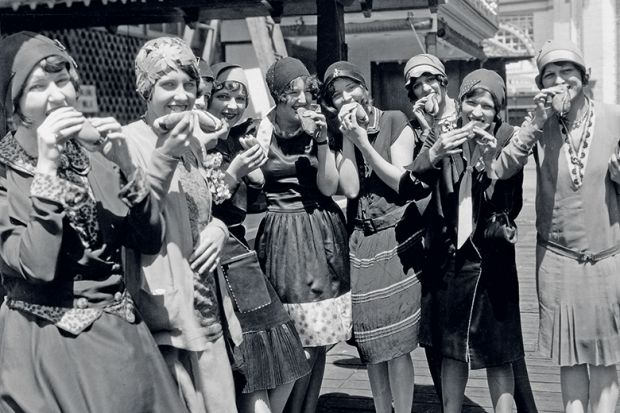 Women eating hot dogs