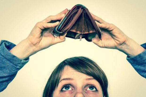 Women looking at empty wallet