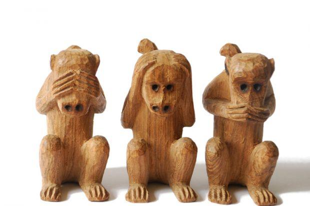 Wood-carved monkeys, see, hear, speak no evil