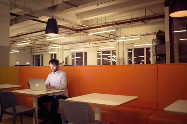 Man working on laptop alone