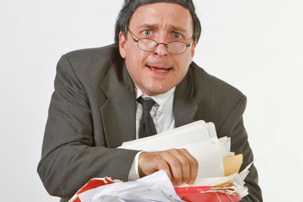 Worried businessman carrying paperwork