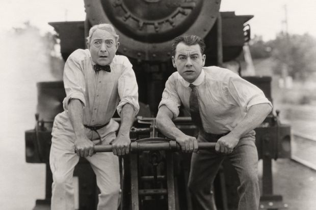Worried men in front of runaway train