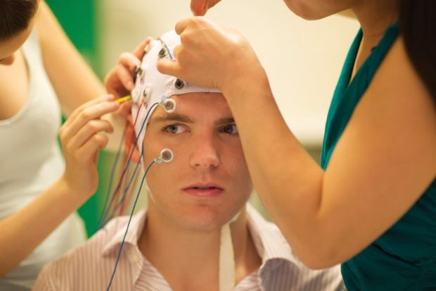 Young man being prepared for brain experiment