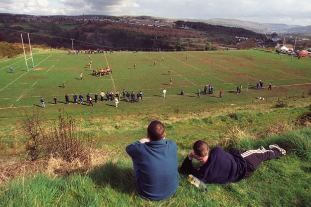 Young men watching rugby match, Cefn coed RFC