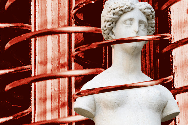 A statue wrapped in red wire