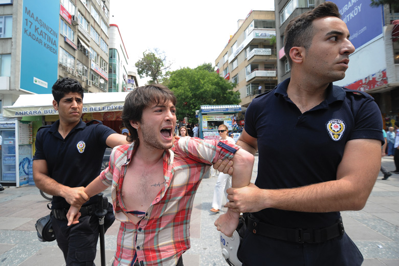 Turkish police detain student protesting against AKP government's education policy
