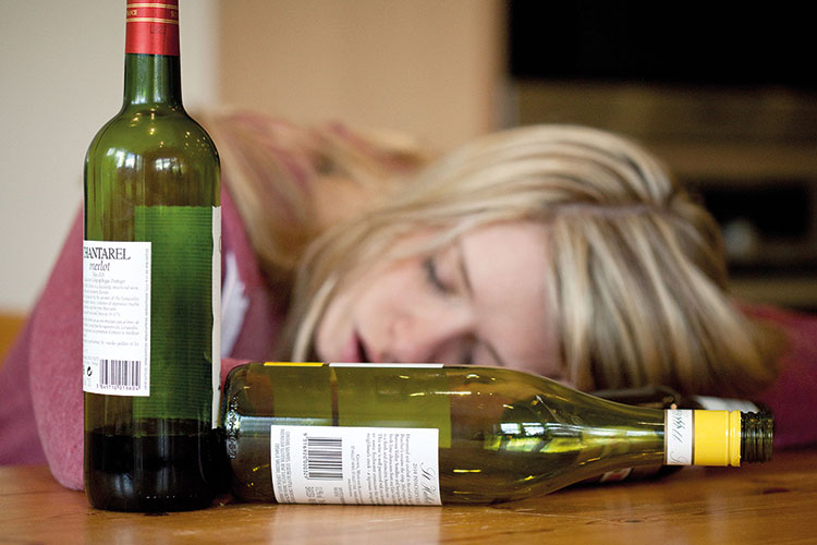 Woman passed out from drinking wine