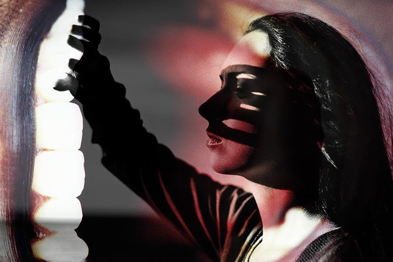 Woman shielding her eyes