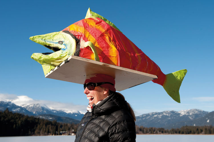 Woman with paper fish on head