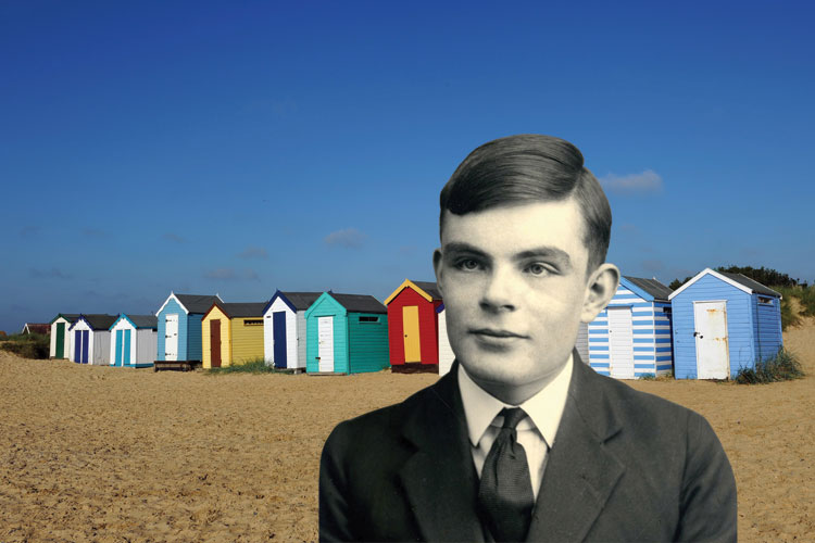 Young Alan Turing in front of beach huts
