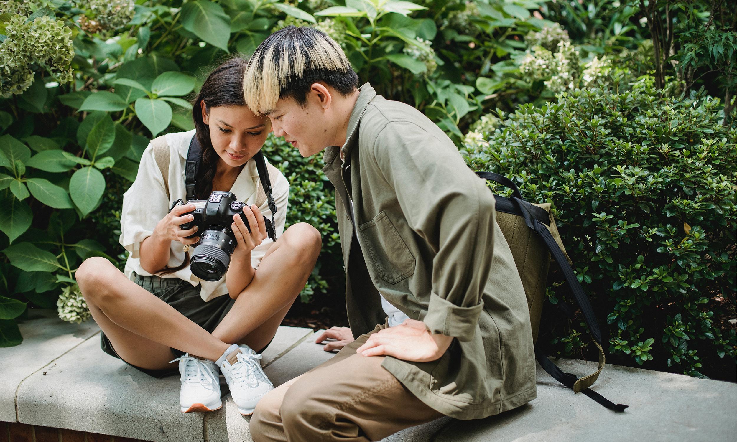 2 students look at a Camera
